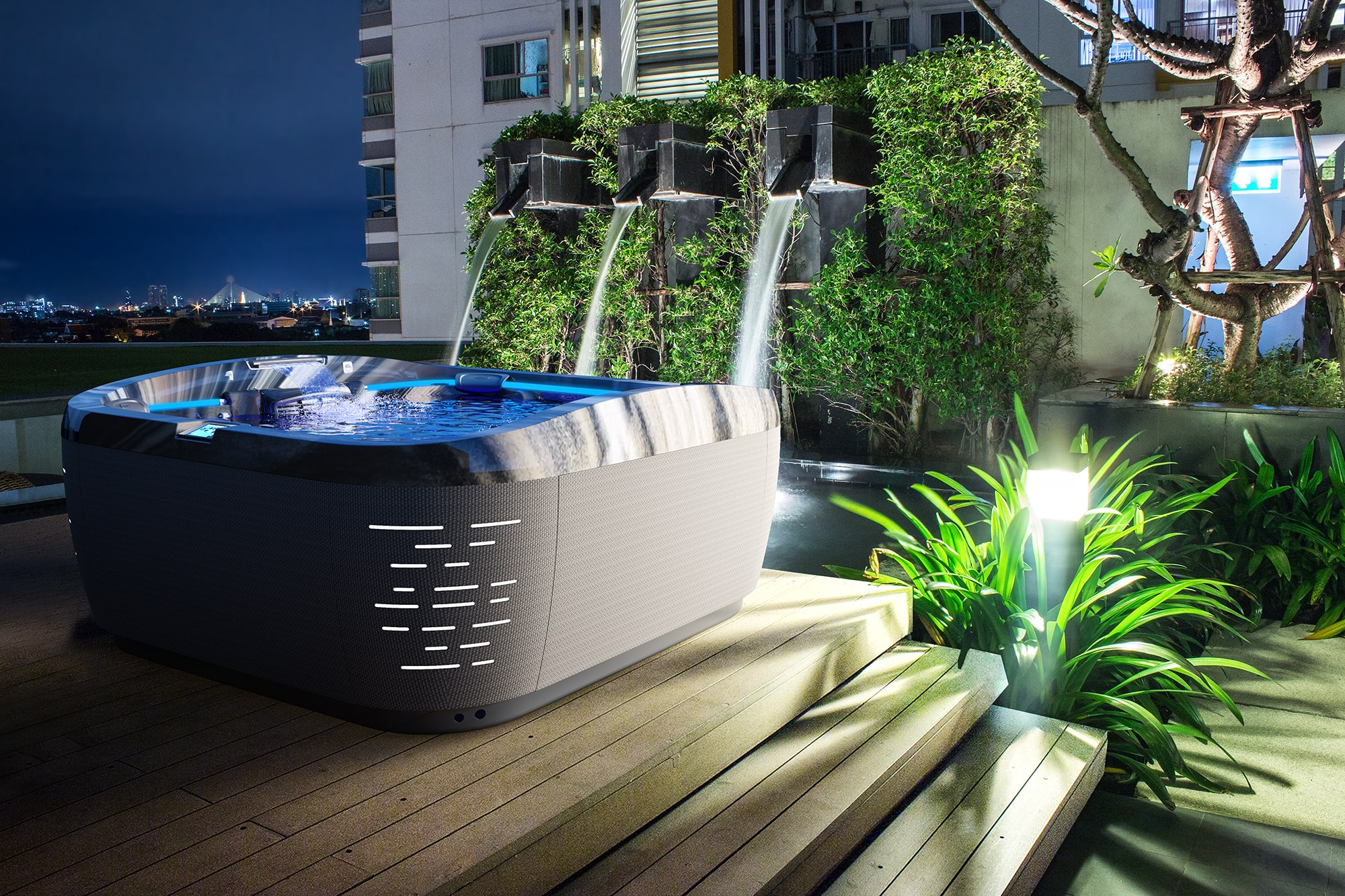 J-575 Jacuzzi Hot Tub installation at night with water falls